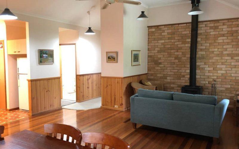 McDonald Cottage living area showing hall and bathroom at Glen Ayr Cottages