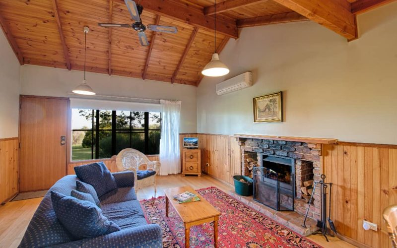 Murray Cottage living area with open fireplace at Glen Ayr Cottages