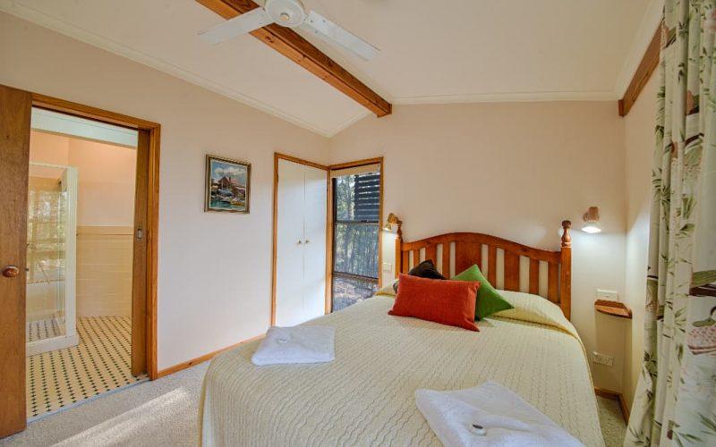Stewart Cottage bedroom showing en-suite at Glen Ayr Cottages