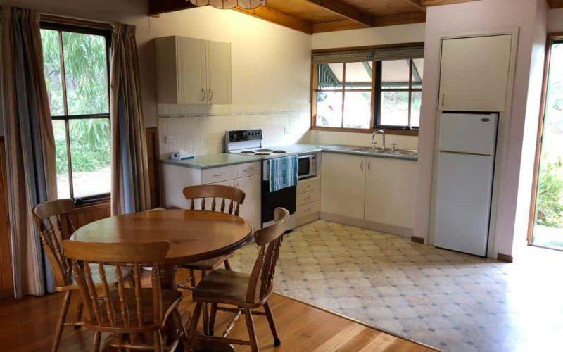Sutherland Cottage kitchen and living area at Glen Ayr Cottages